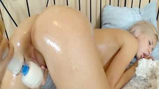 Bitch with fully oiled genitals got it thrilled by a large vibrator