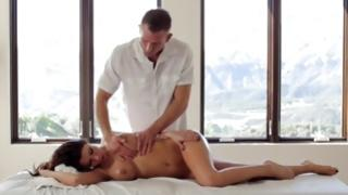 Slender yummy beauty getting her massaged by guy