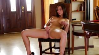 Thrilling brown-haired hottie playing with exquisite toy-joystick