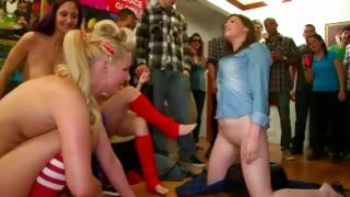 Kinky harlots playing with dildo and pricks at crowd